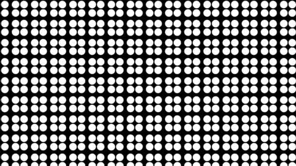 Graphic motif in black and white that moves in the background increasing the size, composed of drawings and colored shapes.