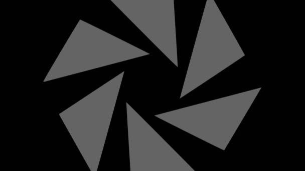 Grafický objekt v černé a bílé barvě se stroboskopickým a hypnotickým efektem, který otáčí ve směru hodinových ručiček zmenšuje velikost z celé obrazovky na mizející ve středu, ve formátu 16: 9 video