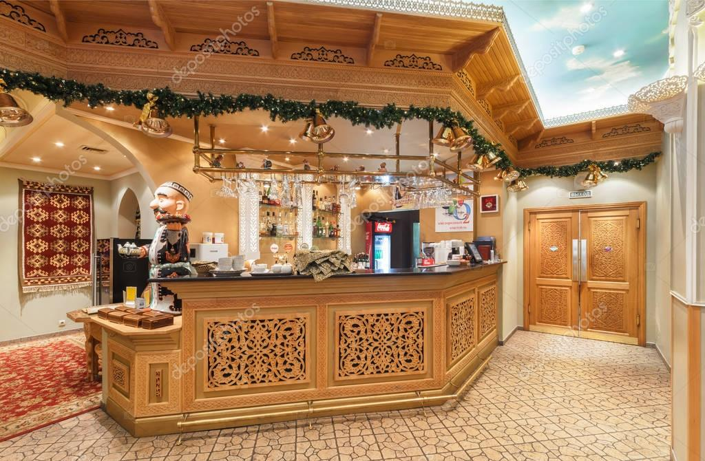 MOSCOW/RUSSIA - DECEMBER 2014. The interior of the deluxe restaurant of Uzbek cuisine - Babay Club in an oriental style. The wooden bar of wood carving