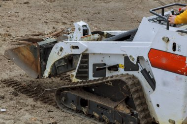 small excavator Bobcat at construction site Skid loader on construction site
