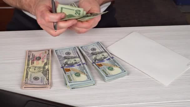 Man counting money,man in business clothes with dollars, Cash in hands. Profits, savings. Stack of dollars. Success, motivation, financial flows, wealth.