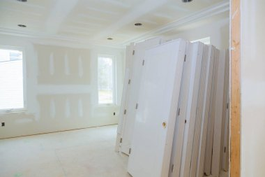 Construction building new home construction interior drywall tape. Building construction gypsum plaster walls