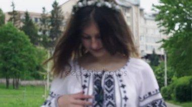A beautiful Ukrainian girl wearing a national dress in a happy dress is a slow motion