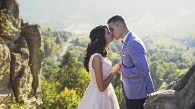 Kissing newly married couple