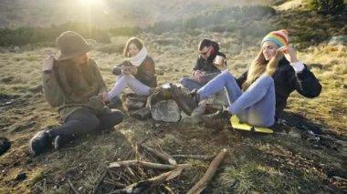 Tea party near campfire.