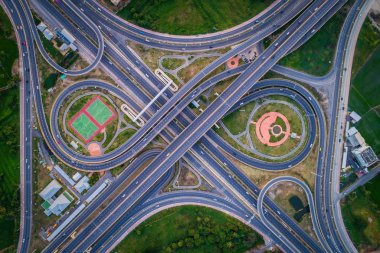 Aerial view Road roundabout with car lots in the city in Thailan