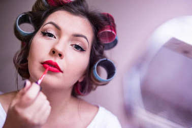 Girl making vintage pin-up make up from 50s