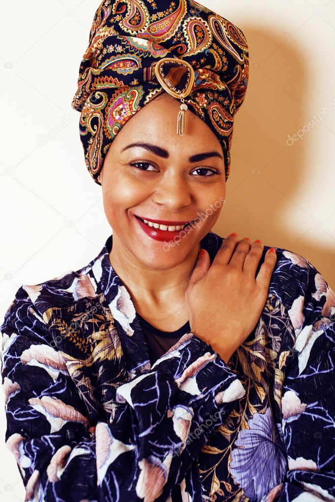 Beauty bright african woman with creative make up, shawl on head like cubian closeup smiling, cheerful tan mulatto, lifestyle people concept
