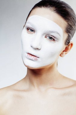young pretty woman with facial mask