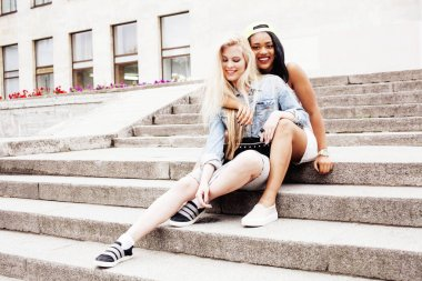 Two teenage girls in front of university