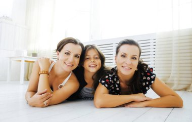 Mature sisters twins with little daughter