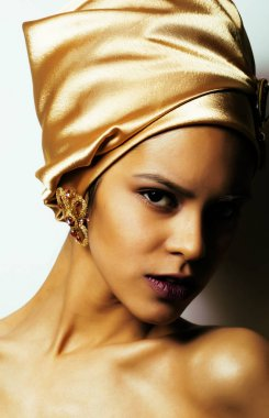 beauty african woman in shawl on head, very elegant look with gold jewelry close up mulatto dark afro