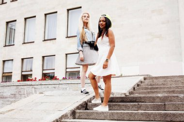 Two teenage girls infront of university