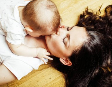 happy mother holding baby son