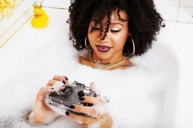 young afro-american teen girl in bath