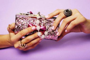woman hands holding small handbag