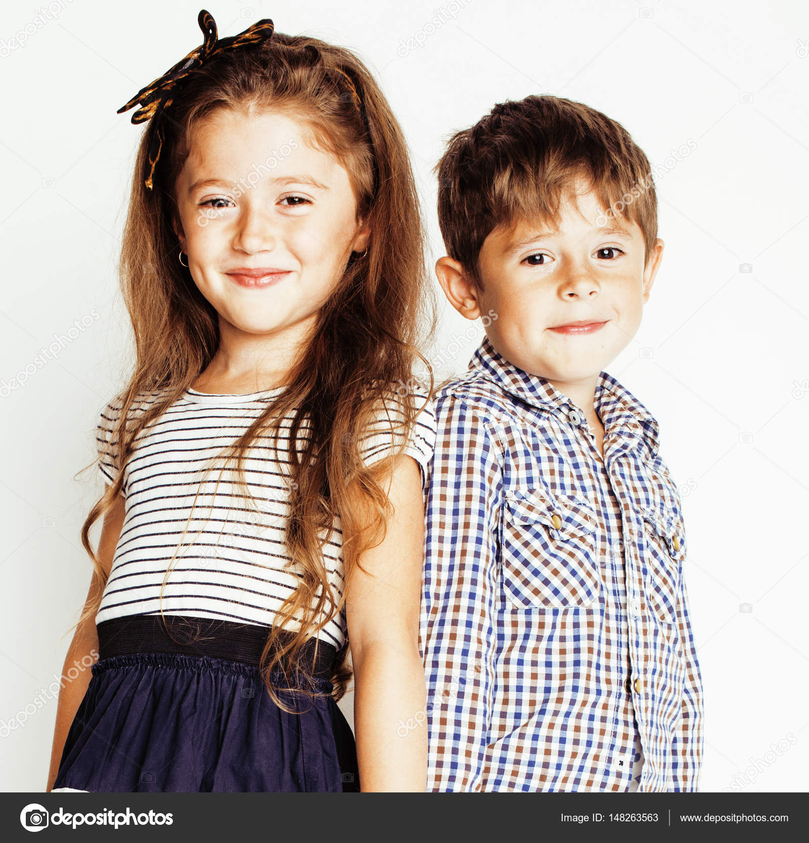 little cute boy and girl hugging playing on white background, happy