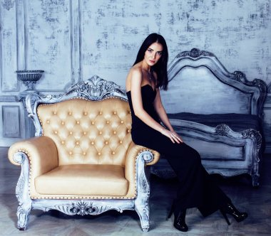 beauty young brunette woman in luxury home interior, fairy bedroom grey stylish