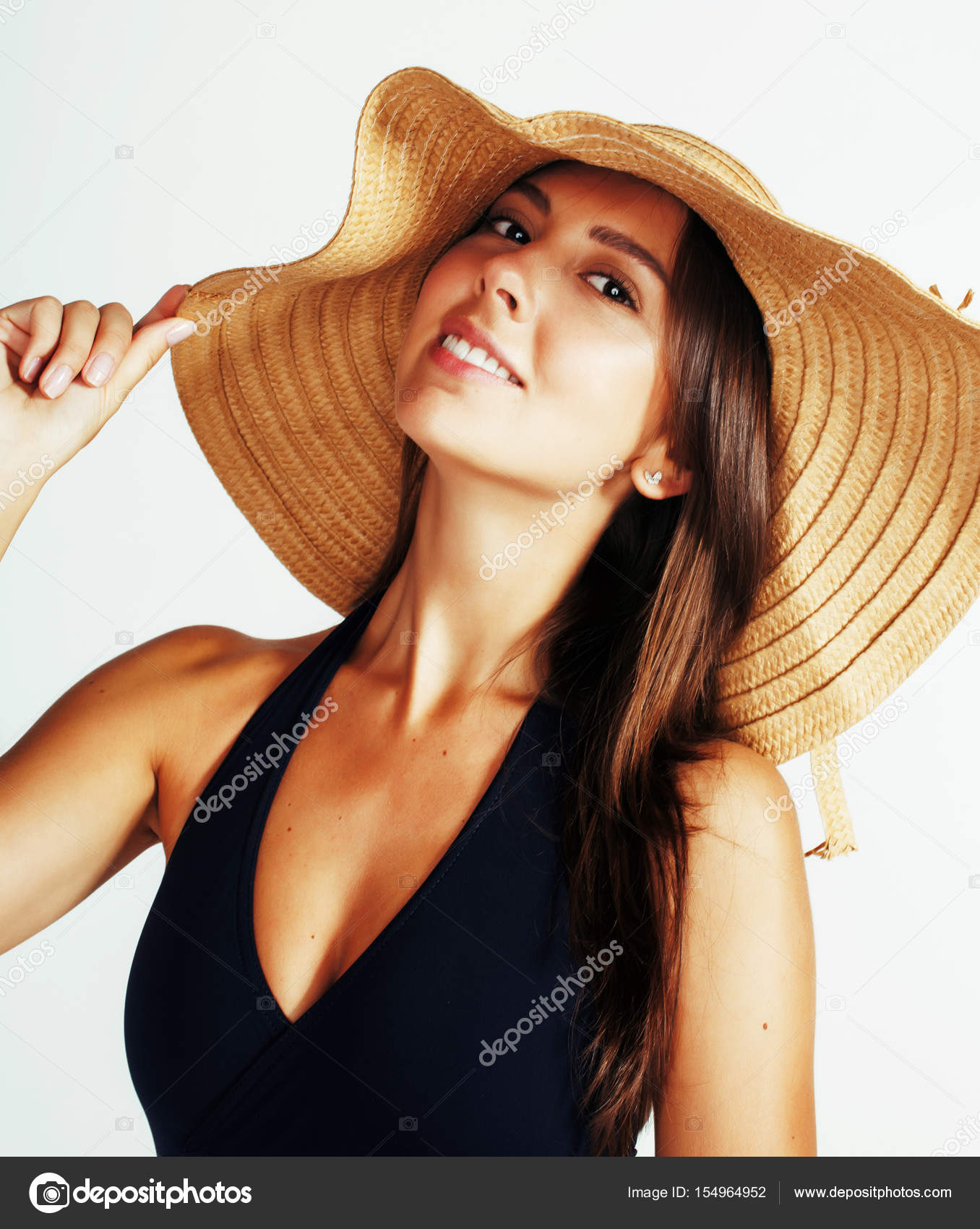 f592faac Young pretty brunette woman wearing summer hat and swimsuit isolated on  white background preparing to vacations, smiling emotional posing,  lifestyle concept ...