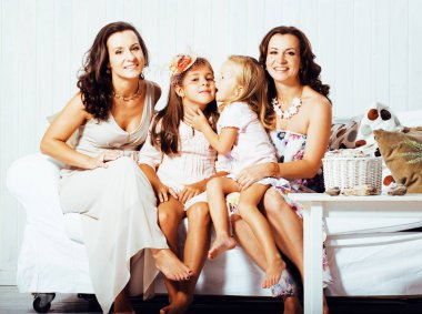 young pretty modern family at home