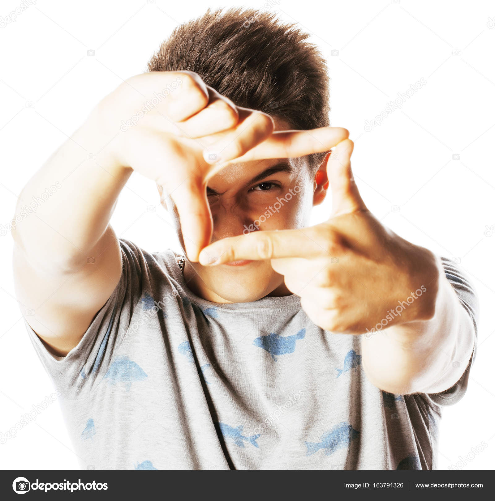 joven bonito encuadre con los dedos — Fotos de Stock © iordani ...