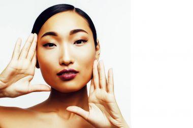 young pretty asian woman posing
