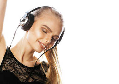young sweet talented teenage girl in headphones singing isolated on white background
