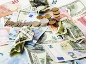 Fotografie Cash on table isolated: dollars, euro, rubl broken money. All in