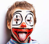 Photo little cute boy with facepaint like clown