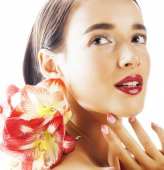 Photo young pretty brunette real woman with red flower amaryllis close