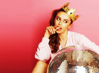 young cute disco girl on pink background with disco ball and cro