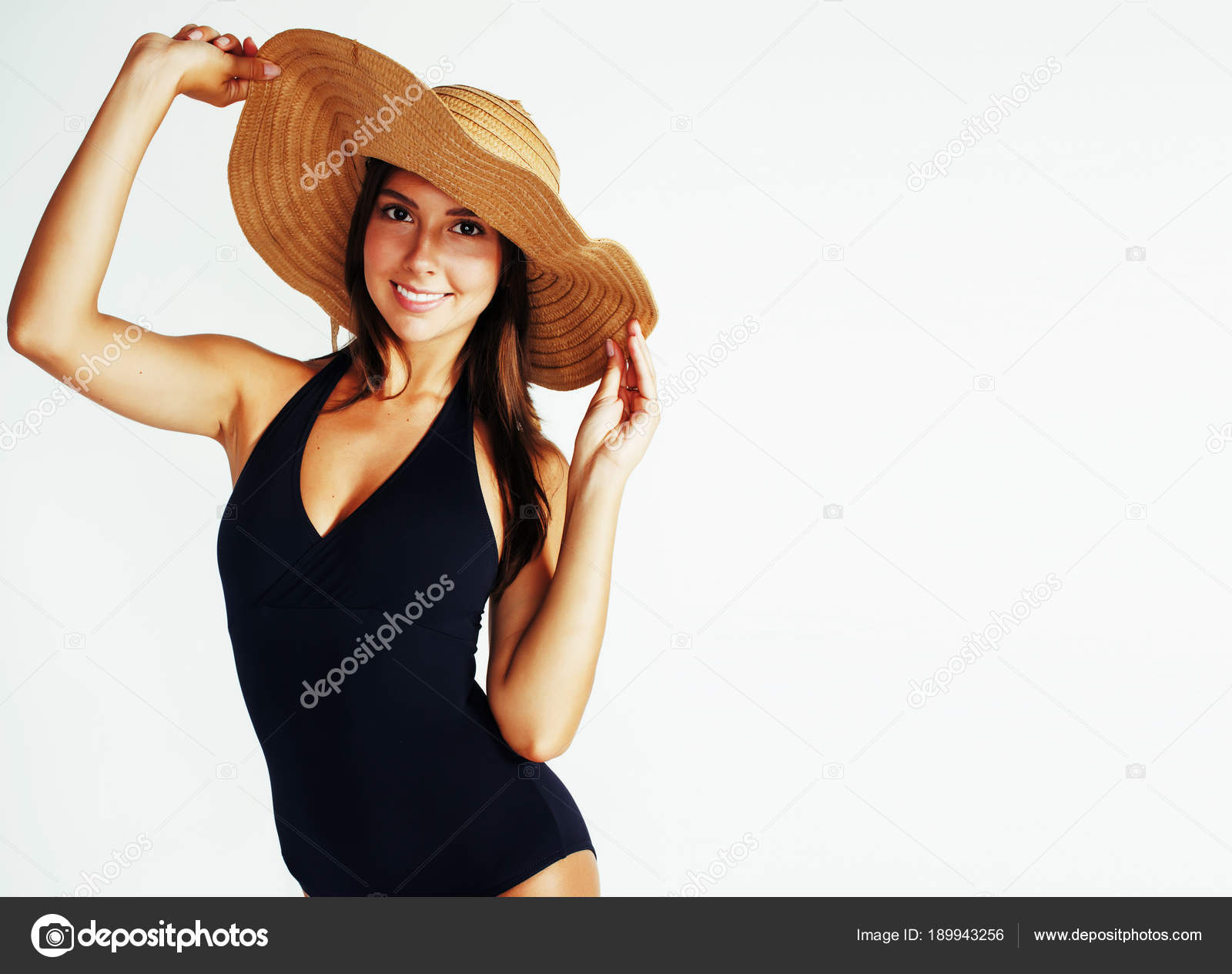 5a6602b0 Young pretty brunette woman wearing summer hat and swimsuit isol — Stock  Photo