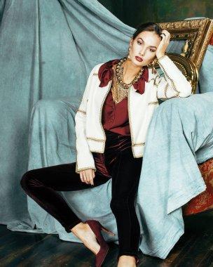 beauty rich brunette woman in luxury interior near empty frames,