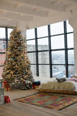 Christmas bedroom interior, Christmas tree by the bed