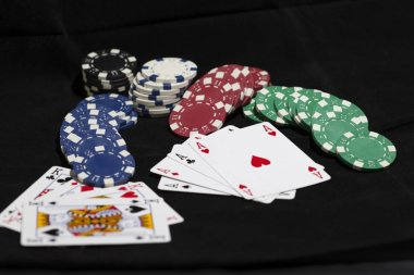 Poker cards with betting chips.