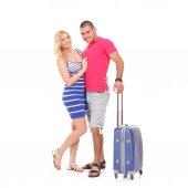 Fotografie mladá žena a muž s kufříkem pro cestování