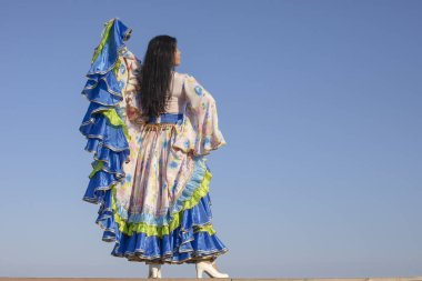 young woman dancing in gypsy dress