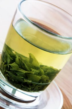 Green tea on a wood background
