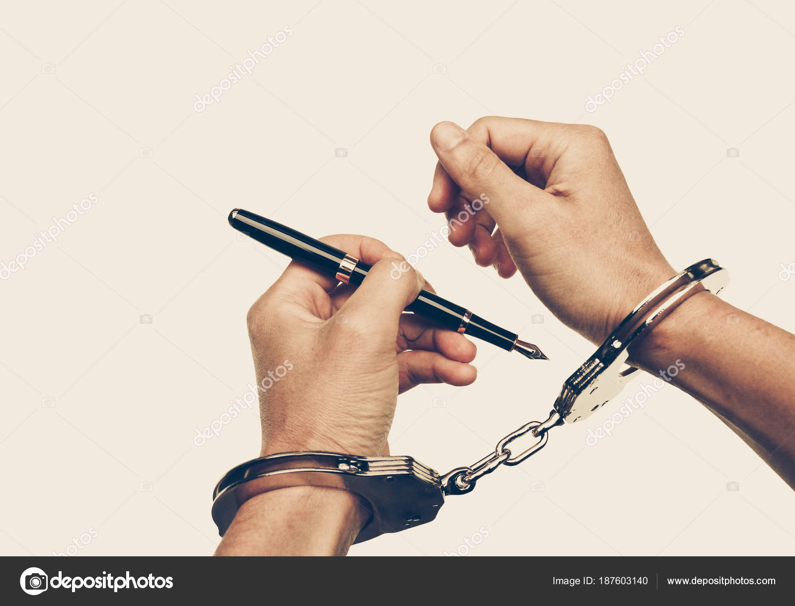 Hand Using Pen Trying Unlock Handcuffs Freedom Press Risk