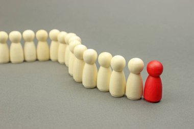 Wooden figures of people. A successful leader leads a team, a business concept