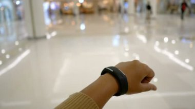 Hands of woman using smart watch for cyber and futuristic concept select focus shallow depth of field
