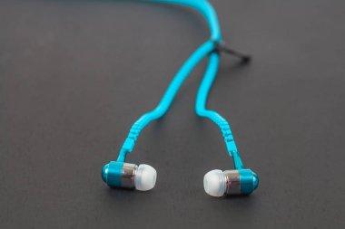 blue earphone and cable line like zipper