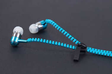 Blue earphone and cable line like zipper