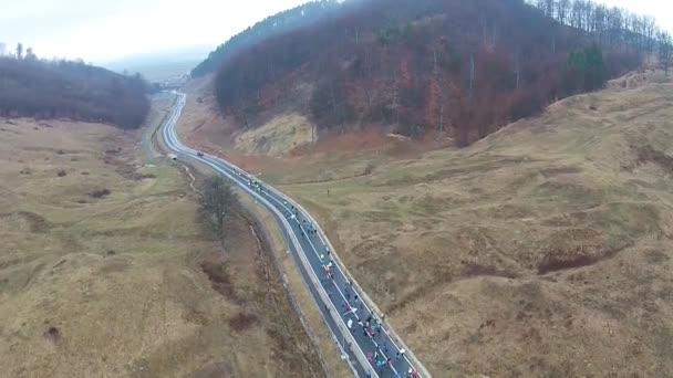 Runners at mountain marathon, aerial view