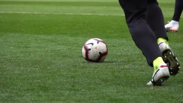 Soccer player kicks the ball, Slow motion
