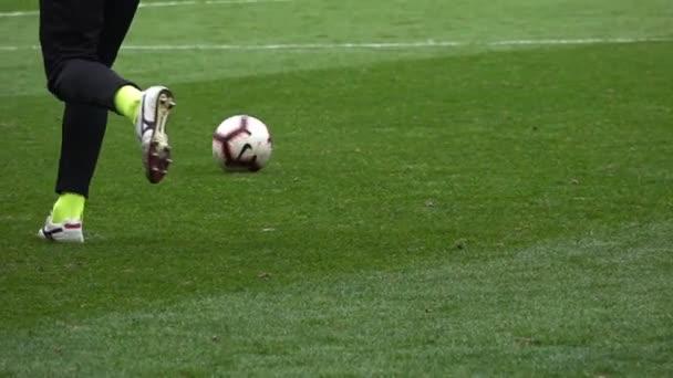 Close-up Soccer player kicks the ball, Slow motion