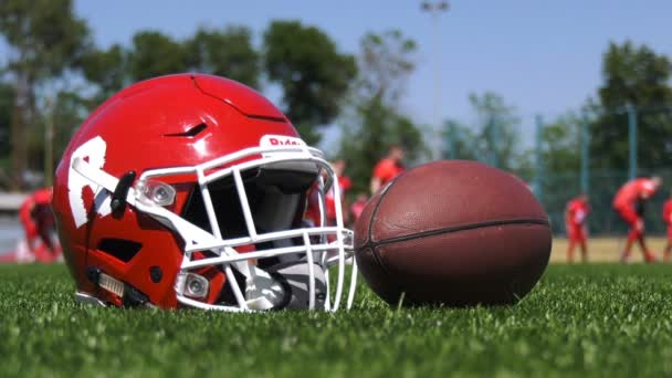 Football Helmet and ball on grass.