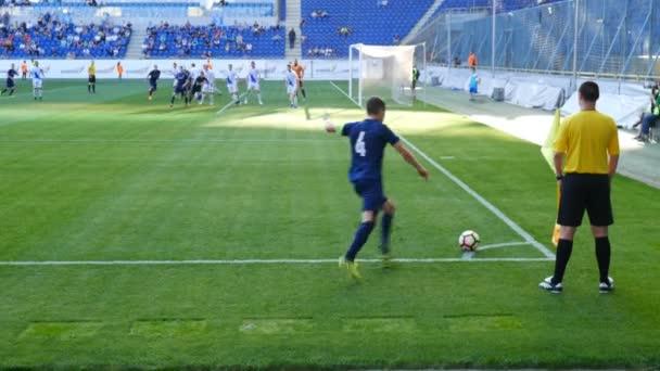 Football match, Soccer match, player takes a corner.