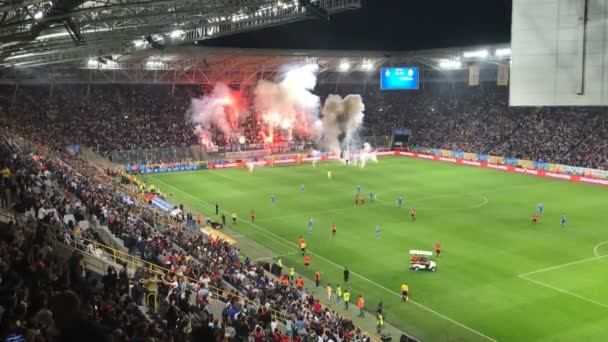 Soccer game. Fans make a pyrotechnic show.  Viewer harness fireworks. Pyrotechnic show at the stadium