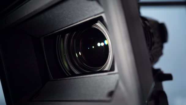 Close-up of camcorder lens, camera rotation and zoom lens. 4k